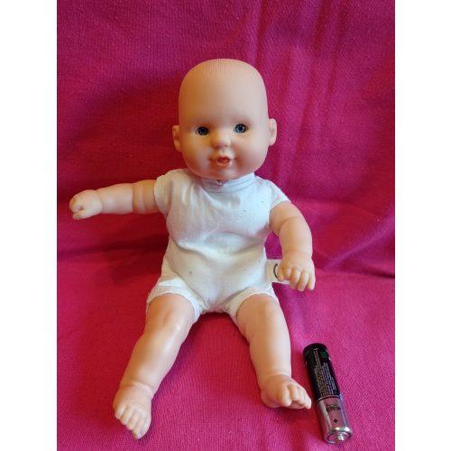 Mosolygós kisméretű baba