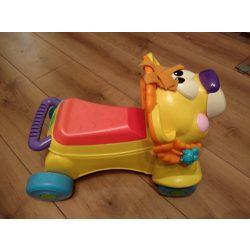 Fisher Price zenélő oroszlán járássegítő és baba taxi egyben (bébi taxi)