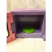 Játék mikrohullámú sütő néhány műanyag kiegészítővel